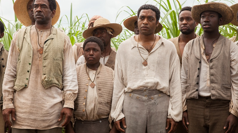 The opening scene of the movie. Chiwetel Ejiofor (middle) plays the character Solomon. Source: Official Fox Searchlight Pictures image