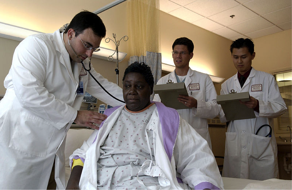 Doctor treats cancer patient