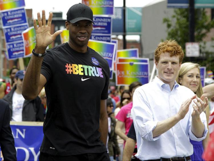 Jason Collins walks in the Boston Pride Parade in June 2013 | Source: Yahoo! Sports