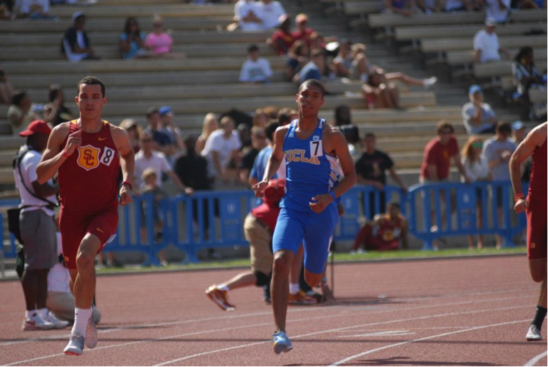 Anthony competing in a track meet versus rival school, USC