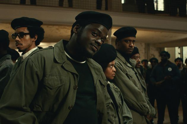 Daniel Kaluuya as Chairman Fred Hampton Jr. addresses a rival group. Lakeith Stanfield as William O'Neil looks over his shoulder behind Hampton.