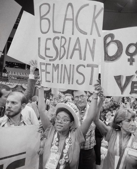 "Protester holding a sign. Sign reads ""Black Lesbian Feminist"""